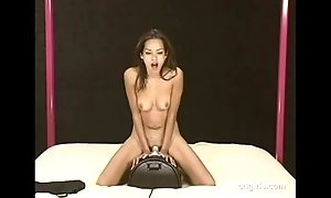 Asian latitudinarian lallapalooza rides the sybian to orgasm for the saucy time eon