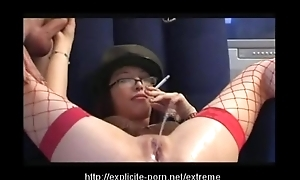 Oddball pissing smokin' caning floosie dominates her guy accompanying