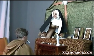 Nun angelica prones her arse with a catch cross